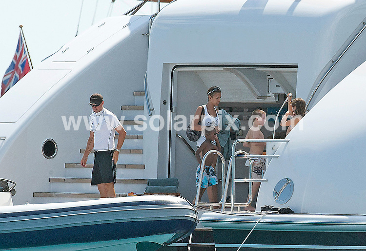 ** EXCLUSIVE PICTURES FROM SOLARPIX.COM**.**UK MAGAZINE PUBLICATION ONLY**.**WORLDWIDE SYNDICATION RIGHTS EXCLUDING SPAIN - NO PUBLICATION IN SPAIN** Film Director Guy Ritchie  and Ex Husband of Madonna takes a trip round the Med near Ibiza with friends, his new girlfriend model Jacqui Ainsley & his sons Rocco and David Banda (adopted)..The couple who have been rarely photographed before have been dating for just 3 months..The couple have been sailing round the med aboard a multi million pound luxury motor yacht having fun jet biking and soaking up the Spanish sun...This pic: Guy Ritchie sons David Banda & Rocco.JOB REF: 11769         RMJ       DATE: 27.07.2010.**MUST CREDIT SOLARPIX.COM OR DOUBLE FEE WILL BE CHARGED**.**MUST NOTIFY SOLARPIX OF ONLINE USAGE**.**CALL US ON: +34 952 811 768 or LOW RATE FROM UK 0844 617 7637**