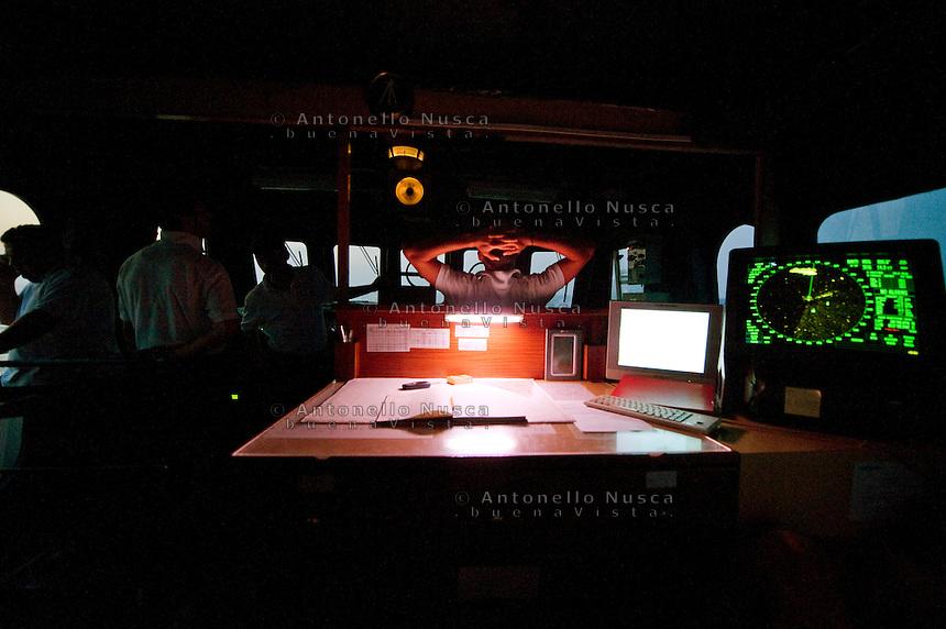 L'equipaggio di una motovedetta della Capitaneria di Porto di Lampedusa, durante un pattugliamento alla ricerca di barche di clandestini provenienti dalla Libia. The crew of Italia Coast Guard during their patrol activities