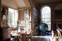 With its array of books, taxidermy, drawers, boxes and a giant globe, the library is reminiscent of the den of an 18th century explorer