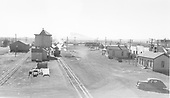 Looking south at D&amp;RGW Antonito facilities.  #476 is taking water here.  Ca. 1940's sedan parked nearby.  Mt. San Antonio is on the horizon.<br /> D&amp;RGW  Antonito, CO  Taken by Richardson, Robert W. - 11/28/1948