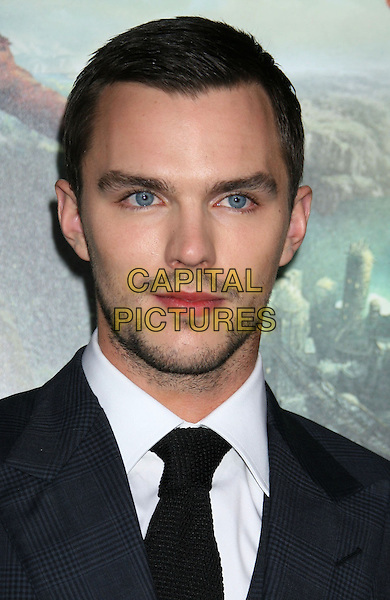 "Nicholas Hoult.""Jack The Giant Slayer"" Los Angeles Premiere held at Grauman's Chinese Theatre, Hollywood, California, USA..February 26th, 2013.headshot portrait black blue tie shirt stubble facial hair check suit .CAP/ADM/RE.©Russ Elliot/AdMedia/Capital Pictures."