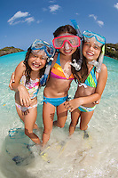 Kids with snorkel gear at the beach<br />