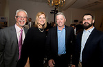 SOUTHINGTON, CT-050318JS14- Dr. Peter Jacoby, Kristen Jacoby, President and CEO of the United Way of Greater Waterbury with Peter Baker of Litchfield Distilleries and Mike Padino of Crystal Rock, at the United Way of Greater Waterbury's 32nd annual Community Leaders Dinner and Awards event at the Aqua Turf in Southington. <br /> Jim Shannon Republican American