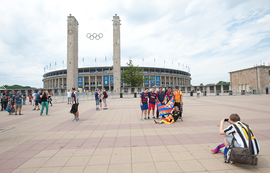 A Juventus fan takes a photograph of a group of Barcelona fans outside the Olympiastadion ahead of the Champions League Final<br /> <br /> Photographer Chris Vaughan/CameraSport<br /> <br /> Football - UEFA Champions League Final - Juventus v Barcelona - Saturday 6th June 2015 - Olympiastadion - Berlin, Germany<br /> <br /> &copy; CameraSport - 43 Linden Ave. Countesthorpe. Leicester. England. LE8 5PG - Tel: +44 (0) 116 277 4147 - admin@camerasport.com - www.camerasport.com