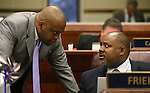 Nevada Assembly Democrats William Horne, left, and Jason Frierson talk on the Assembly floor at the Legislative Building in Carson City, Nev., on Monday, April 22, 2013. .Photo by Cathleen Allison