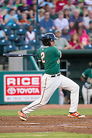 Austin Dean (2) of the Greensboro Grasshoppers follows through on his swing against the Hagerstown Suns at NewBridge Bank Park on June 21, 2014 in Greensboro, North Carolina.  The Grasshoppers defeated the Suns 8-4. (Brian Westerholt/Four Seam Images)