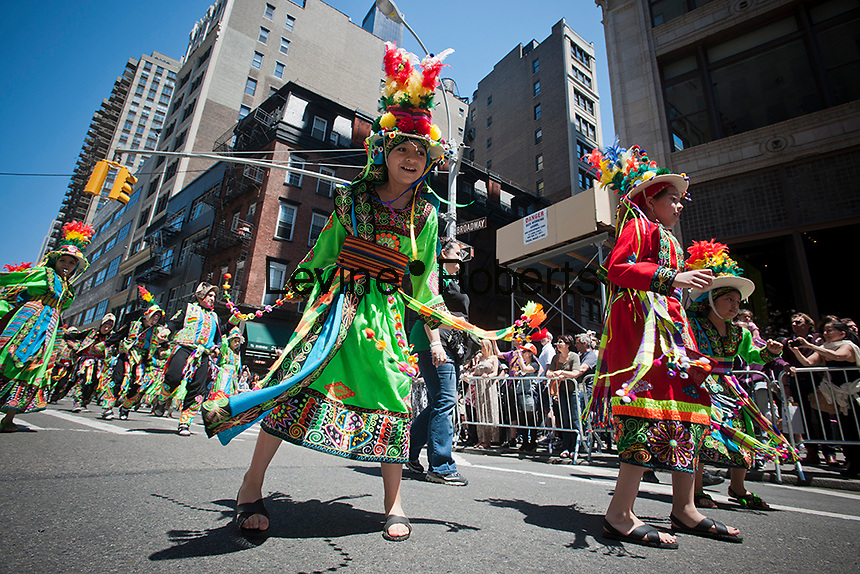 Hispanic dancers perform on Broadway in New York in the Sixth Annual Dance Parade on Saturday, May 19, 2012.  The parade showcases many of the cultural and artistic dance troupes that exist in the multicultural city.  (© Richard B. Levine)
