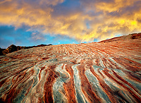 Bands of striated, colorful rocks. Valley of Fire State Park, Nevada. Sky added.