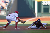 Mississippi State outfielder Hunter Renfro (34) slides awkwardly as Indiana Hoosiers third baseman Dustin DeMuth (16) tags him out in the first inning against the Indiana Hoosiers during Game 6 of the 2013 Men's College World Series on June 17, 2013 at TD Ameritrade Park in Omaha, Nebraska. The Bulldogs defeated Hoosiers 5-4. (Andrew Woolley/Four Seam Images)