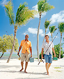 USA, Florida, two men walking on beach with fishing rods and tackle boxes, Islamorada