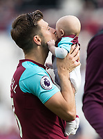Aaron Cresswell of West Ham with family at full time during the Premier League match between West Ham United and Everton at the Olympic Park, London, England on 13 May 2018. Photo by Andy Rowland / PRiME Media Images.