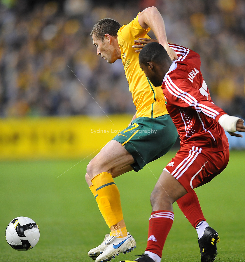 MELBOURNE, AUSTRALIA - OCTOBER 14: Brett Emerton from Australia fends off an opponent in a AFC Asian Cup 2011 match between Australia and Oman at Etihad Stadium on October 14, 2009 in Melbourne, Australia. Photo Sydney Low www.syd-low.com