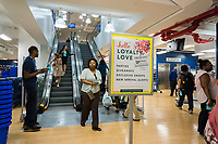 A sign advertises the TJX rewards program in the brand new Marshalls store in Lower Manhattan in New York during it's grand opening on Thursday, May 18, 2017. The TJX Companies, parent of Marshalls and T. J. Maxx, after 10 quarters of sales growth, recently reported sales growth that missed analysts' expectations. Unfavorable weather was cited as the reason.  (© Richard B. Levine)