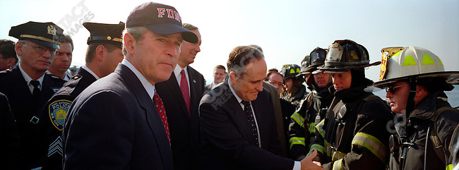 U.S. President George W. Bush visits Ground Zero with New York City Mayor Rudolph Guiliani. New York City, October 2001.