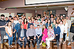 John McMahon, Currow, seated centre, got a giant of a surprise when he walked into O'Riada's of Ballymac last Saturday night to find a big 21st birthday party organised for him.
