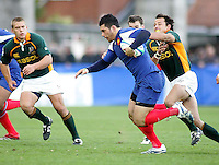 French centre Yann David on the attack during the Division A U19 World Championship clash at Ravenhill.