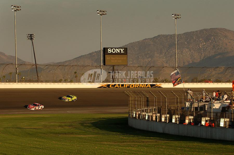 Sept. 3, 2006; Fontana, CA, USA; Nascar Nextel Cup driver Kasey Kahne (9) leads Kyle Busch (5) during the Sony HD 500 at California Speedway. Mandatory Credit: Mark J. Rebilas.
