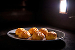 A plate full of gougeres are cooked in the oven at Cakes & Ale, photographed for Choice Tables on Friday, April 22, 2011 in Decatur. GA.  (Rich Addicks/Photographer) 10110950A