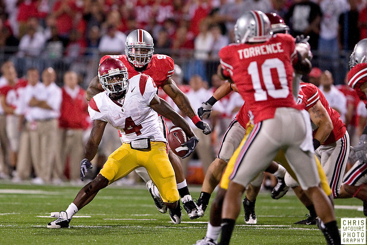 12 September 2009:  Football -- USC running back Joe McKnight gains rushing yards during their final scoring drive against Ohio State  at Ohio Stadium in Columbus.  USC won 18-15.  Photo by Christopher McGuire.