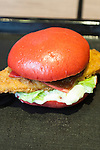 Burger King's red burger ''AKA SAMURAI CHICKEN'' went on sale on July 3, 2015, in Tokyo, Japan. The two new burgers ''AKA SAMURAI CHICKEN'' and ''AKA SAMURAI BEEF'' use red buns and red cheese, colored by tomato powder and spicy red sauce and will be sold at Japanese branches until August. The AKA SAMURAI CHICKEN costs 540 JPY (4.39 USD) and the AKA SAMURAI BEEF costs at 690 JPY (5.61 USD). As a part of the promotion Burger King plans to launch two new black burgers on August 21st. (Photo by Rodrigo Reyes Marin/AFLO)