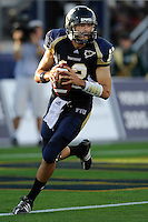20 September 2008:  FIU quarterback Paul McCall (12) scrables in the second quarter of the USF 17-9 victory over FIU at FIU Stadium in Miami, Florida.