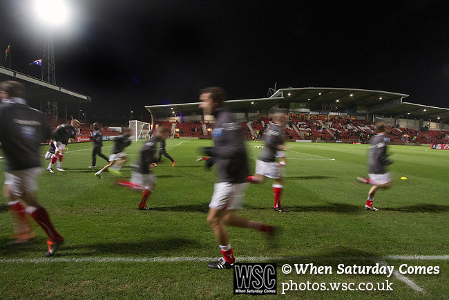 Wrexham 1 Brighton & Hove Albion 1, 18/01/2012. Racecourse Ground, FA Cup 3rd Round Replay. Home players going through their pre-match warm-up routine at the Racecourse Ground, before Wrexham hosted Brighton and Hove Albion in an FA Cup third round replay, played following the teams one-all draw in the first match. The replay was won by Brighton, 5-4 on penalty kicks after the match had ended in a one-all draw after extra time, watch by a crowd of 8316. The visitors played in the Championship, three leagues above their rivals from Wales, who were top of the Conference at the time of the match. Photo by Colin McPherson.
