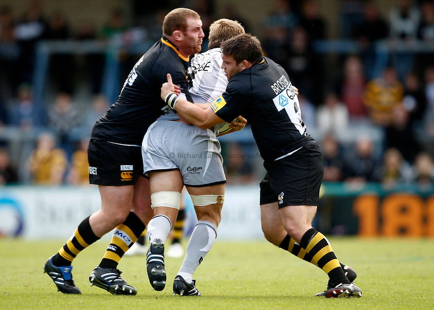 Photo: Richard Lane/Richard Lane Photography. London Wasps v Leicester Tigers. Aviva Premiership. 18/09/2010. Wasps' props, Tim Payne and Ben Broster make a tackle.