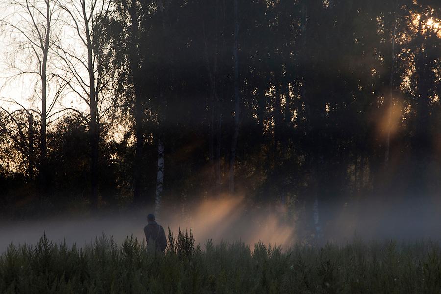 Korovikha, Ivanova Region, Russia, 06/08/2012..A farmer herds cattle through the early morning mist in Korovikha, some 200 miles east of Moscow.