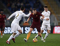 Calcio, Serie A: Roma vs Milan. Roma, stadio Olimpico, 12 dicembre 2016.<br /> Roma&rsquo;s Edin Dzeko, center, is challenged by Milan's Mattia De Sciglio, left, and Mario Pasalic during the Italian Serie A football match between Roma and AC Milan at Rome's Olympic stadium, 12 December 2016.<br /> UPDATE IMAGES PRESS/Isabella Bonotto
