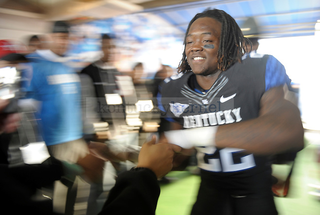 Kentucky Wildcats linebacker Danny Trevathan (22) after winning the University of Kentucky football game against Tennessee at Commonwealth Stadium in Lexington, Ky., on 11/26/11. Uk won the game 10-7. Photo by Mike Weaver | Staff