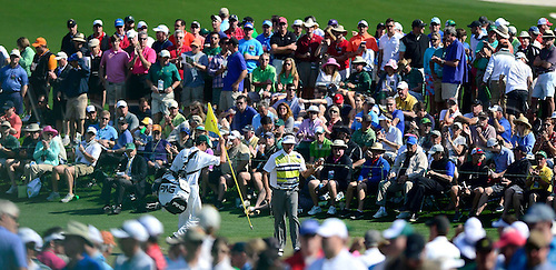 11.04.2014. Augusta, GA, USA - Bubba Watson acknowledges the fans' applause along the 2nd green in the second round at the Masters Tournament in August, Ga., on Friday, April 11, 2014.