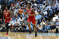 CHAPEL HILL, NC - FEBRUARY 25: Markell Johnson #11 of North Carolina State University dribbles the ball up the court during a game between NC State and North Carolina at Dean E. Smith Center on February 25, 2020 in Chapel Hill, North Carolina.