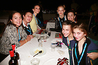 Team Australia poses for photo during banquet at 2006 Portimao World Cup of Rhythmic Gymnastics on September 10, 2006. Some id's...(L-R) coach(?), Meryl Papas (head of delegation), Kimberly Mason, Keziah Oliver, unknown(?), Danielle Prince, Eloise Bankowski (sorry for soft focus).  (Photo by Tom Theobald)  Photo note: There is a 2nd frame, very similiar to this one. Contact me if interested.