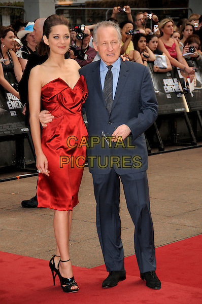 MARION COTILLARD & MICHAEL MANN.European Premiere of 'Public Enemies' at the Empire Cinema, Leicester Square, London, England..June 29th 2009.full length red strapless silk satin dress black shoes blue suit.CAP/CAS.©Bob Cass/Capital Pictures.