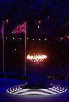 12 AUG 2012 - LONDON, GBR - The Olympic Flame casts a warm glow on the Union flag during the London 2012 Olympic Games Closing Ceremony in the Olympic Stadium in the Olympic Park, Stratford, London, Great Britain (PHOTO (C) 2012 NIGEL FARROW)