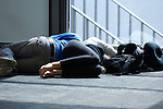 Travelers sleep in a sunny corner of the airport