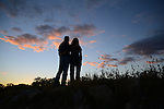 David Stephenson, left, photojournalism advisor for The Kentucky Kernel and his wife Angie Stephenson, watch the sunset together at John Asher Strip Mine in Hyden, Ky., on Friday, October 11, 2013. Photo by Eleanor Hasken