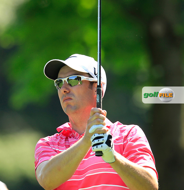 Ross Fisher (ENG) tees off the par3 17th tee during Thursday's Round 1 of the 2013 BMW International Open held on the Eichenried Golf Club, Munich, Germany. 20th June 2013<br /> (Picture: Eoin Clarke www.golffile.ie)