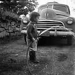 Pleasant Hills PA: Cathleen Brady Stewart helping dad wash the 1946 Chevrolet - 1949.