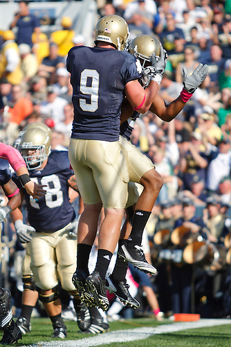 Notre Dame wide receiver Michael Floyd (#3) and tight end Kyle Rudolph (#9) celebrate touchdown during NCAA football game between Pittsburgh and Notre Dame.  The Notre Dame Fighting Irish defeated the Pittsburgh Panthers 23-17 in game at Notre Dame Stadium in South Bend, Indiana.