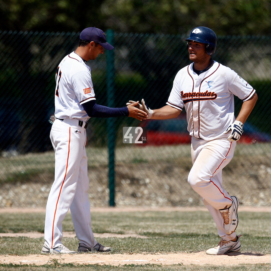 15 July 2011: Guillaume Felices of Montpellier runs the bases after his home run during the 2011 Challenge de France match won 10-7 by the Montpellier Barracudas over Montigny Cougars, in Les Andelys, near Rouen, France.