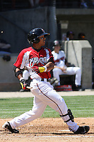 Jose Castro #2 of the Carolina Mudcats hitting during a game against the Montgomery Biscuits on April 18, 2010 in Zebulon, NC.  He broke his bat on the swing, and you can see the wood fragments around him in the air in the photo.