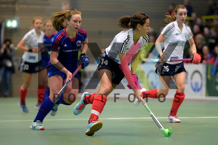 GER - Luebeck, Germany, February 07: During the 1. Bundesliga Damen indoor hockey final match at the Final 4 between Mannheimer HC (blue) and Duesseldorfer HC (white) on February 7, 2016 at Hansehalle Luebeck in Luebeck, Germany.   Selin Oruz #14 of Duesseldorfer HC