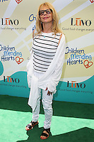 "BEVERLY HILLS, CA, USA - JUNE 14: Rosanna Arquette at the Children Mending Hearts' 6th Annual Fundraiser ""Empathy Rocks: A Spring Into Summer Bash"" on June 14, 2014 in Beverly Hills, California, United States. (Photo by Celebrity Monitor)"