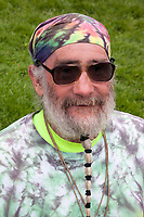 Bearded hippie man wearing green tie-dye bandana and shirt, Northwest Folklife Festival 2016, Seattle Center, Washington, USA.
