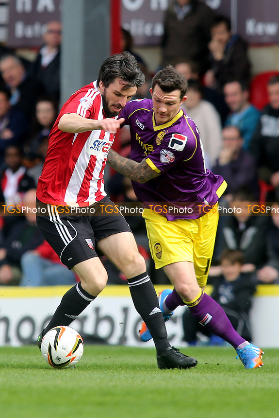 Jonathan Douglas of Brentford and Notts County's Jimmy Spencer - Brentford vs Notts County - Sky Bet League One Football at Griffin Park, London - 05/04/14 - MANDATORY CREDIT: Paul Dennis/TGSPHOTO - Self billing applies where appropriate - 0845 094 6026 - contact@tgsphoto.co.uk - NO UNPAID USE