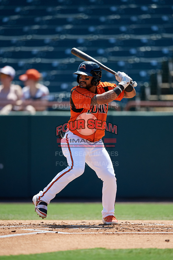 Bowie Baysox Jesmuel Valentin (10) bats during an Eastern League game against the Binghamton Rumble Ponies on August 21, 2019 at Prince George's Stadium in Bowie, Maryland.  Bowie defeated Binghamton 7-6 in ten innings.  (Mike Janes/Four Seam Images)