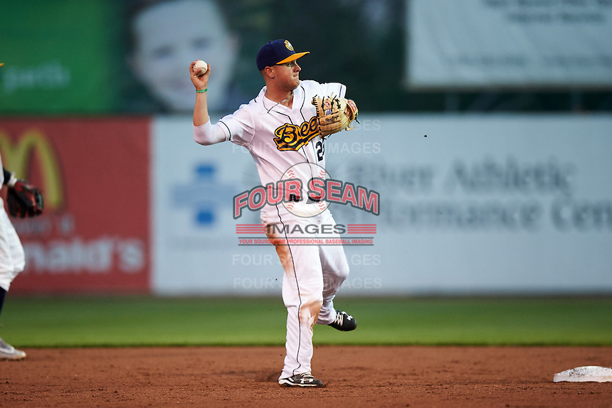 Burlington Bees second baseman Brendon Sanger (23) throws to first after fielding a ground ball up the middle during a game against the Bowling Green Hot Rods on May 7, 2016 at Community Field in Burlington, Iowa.  Bowling Green defeated Burlington 11-1.  (Mike Janes/Four Seam Images)