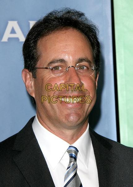 JERRY SEINFELD .at NBC Universal's Press Tour Cocktail Party held at The Langham Huntington Hotel & Spa in Pasadena, California, USA, January 10th 2010.                                                                   .portrait headshot glasses smiling tie blue white shirt .CAP/RKE/DVS.©DVS/RockinExposures/Capital Pictures.