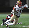 Deyvon Wright #21 of Half Hollow Hills West dashes downfield during the Class III Long Island Championship against Plainedge at Shuart Stadium in Hempstead on Saturday, Nov. 24, 2018.